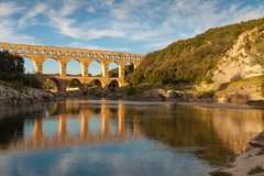 The Pont du Gard is an ancient Roman aqueduct that crosses the Gardon River in southern France